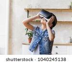 little girl with glasses of... | Shutterstock . vector #1040245138