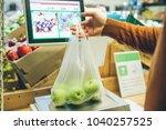 man weigh fruits on digital...   Shutterstock . vector #1040257525