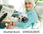 Happy Senior Woman Hugging Her...
