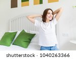 young woman stretching in her... | Shutterstock . vector #1040263366
