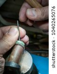 inlaying gemstone on the ring | Shutterstock . vector #1040265076