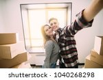 happy young couple moving to... | Shutterstock . vector #1040268298