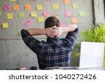 back of entrepreneur sitting in ...   Shutterstock . vector #1040272426