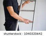 an electrician holds an... | Shutterstock . vector #1040320642