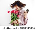 happy stylish girl smiling and... | Shutterstock . vector #1040336866