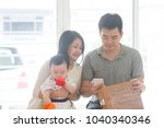 chinese father scanning qr code ... | Shutterstock . vector #1040340346