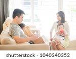 chinese man scanning qr code... | Shutterstock . vector #1040340352