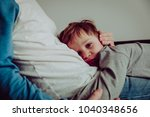 sad child hugging dad at home ... | Shutterstock . vector #1040348656