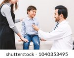 doctor examination little boy... | Shutterstock . vector #1040353495