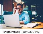 shocked man in eyeglasses... | Shutterstock . vector #1040370442