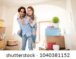 couple moving to a new home  ... | Shutterstock . vector #1040381152