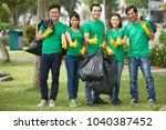 team of young vietnamese... | Shutterstock . vector #1040387452