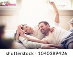 young couple at morning taking... | Shutterstock . vector #1040389426