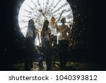 four women with golden confetti | Shutterstock . vector #1040393812