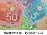 Canadian Dollar Bills On Table...