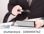 businessman checking a tablet... | Shutterstock . vector #1040404762