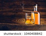 whiskey glass and bottle on the ... | Shutterstock . vector #1040408842