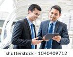 young handsome businessmen... | Shutterstock . vector #1040409712