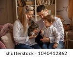 happy family playing with... | Shutterstock . vector #1040412862