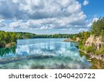 sunny day over lake  forest on... | Shutterstock . vector #1040420722