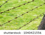 barbed wire fence | Shutterstock . vector #1040421556