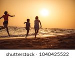 happy children playing on the... | Shutterstock . vector #1040425522