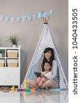 the little girl learning... | Shutterstock . vector #1040433505