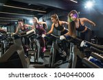 group of fitness girls riding... | Shutterstock . vector #1040440006