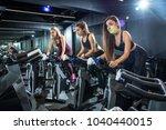 group of three sportswomen... | Shutterstock . vector #1040440015