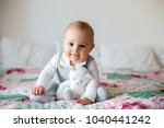 portrait of a cute smiling... | Shutterstock . vector #1040441242