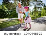 father teaching his daughter to ... | Shutterstock . vector #1040448922