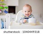 cute little baby boy  eating... | Shutterstock . vector #1040449318