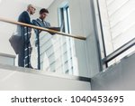 low angle view of two... | Shutterstock . vector #1040453695
