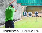 the man shooting with gun | Shutterstock . vector #1040455876