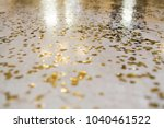 the gold confetti on the floor. ...   Shutterstock . vector #1040461522