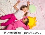kids in pink pajamas lie close... | Shutterstock . vector #1040461972