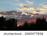 white clouds against the blue... | Shutterstock . vector #1040477836
