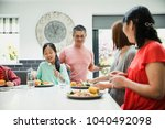 family are sitting down to have ... | Shutterstock . vector #1040492098