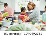 family are preparing vegetables ... | Shutterstock . vector #1040492152