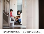 little boy is sitting at the... | Shutterstock . vector #1040492158