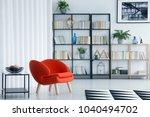 orange armchair next to table... | Shutterstock . vector #1040494702