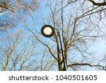 lantern in the park against the ... | Shutterstock . vector #1040501605