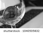 bitcoin in a glass on laptop... | Shutterstock . vector #1040505832