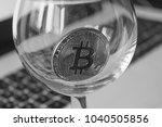 bitcoin in a glass on laptop... | Shutterstock . vector #1040505856
