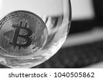 bitcoin in a glass on laptop... | Shutterstock . vector #1040505862