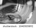 bitcoin in a glass on laptop... | Shutterstock . vector #1040505892