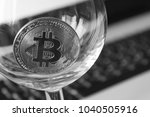 bitcoin in a glass on laptop... | Shutterstock . vector #1040505916