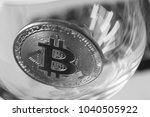 bitcoin in a glass on laptop... | Shutterstock . vector #1040505922