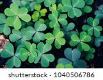 green background with three... | Shutterstock . vector #1040506786