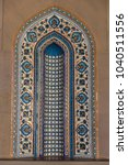 Small photo of MUSCAT, OMAN - NOVEMBER 30, 2017: tile mosaic with contemporary ceramics and pattern style in Sultan Qaboos Grand Mosque in Muscat, Oman